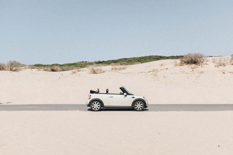 white mini on desert road