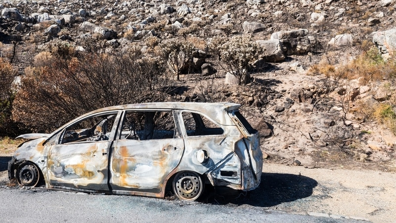 burned out car along the side of the road in Cape Town South Africa