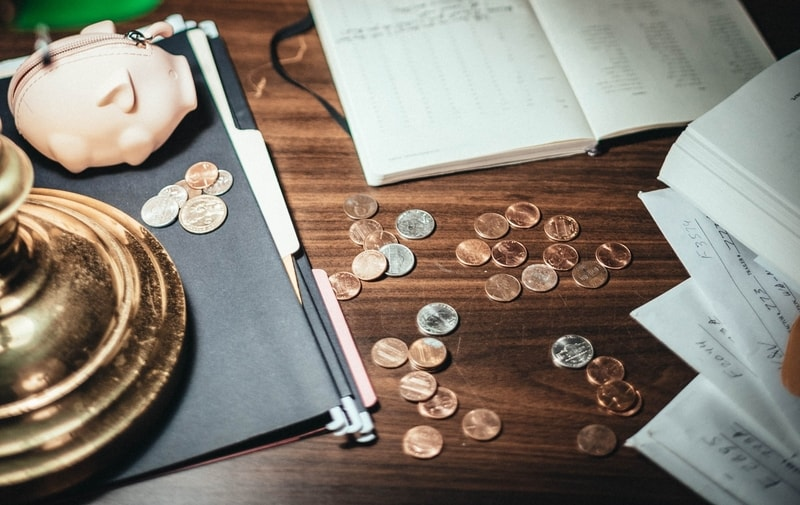 coins-and-financial-folders-scattered-on-desk