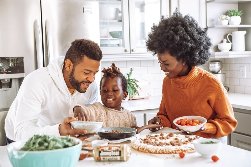 small family laughing around supper table