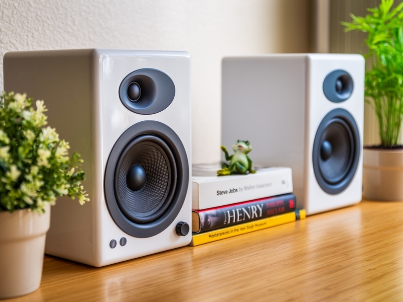 white speaker set on a table in home