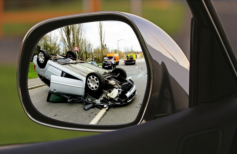 car accident in side mirror of car
